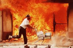"A storefront ablaze in South Central Los Angeles in during riots sparked by a videotape of police beating Rodney King.: ""Now someone shouts: 'Remember Vietnam!' And someone else: 'Remember Rodney King!' Another: 'Terror doesn't need a bomb! Hyungwon, Rodney King, Los Angeles Police Department, Latest Images, Black History, American History, At Least, Funny Pictures, Angels"