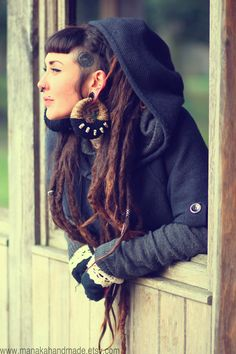 Elegant and punk. (partial dreads, partially shaved, gauged ears, septum piercing, long dreads)