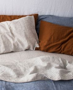 Home bedroom - Baby blue chambray french linen quilt cover complimented by a soft grey stripe and an Ochre pillowcase set How dreamy! Cozy Bedroom, Bedroom Inspo, Dream Bedroom, Master Bedroom, Bedroom Decor, Master Suite, Chambray, Dark Wood Furniture, Paint Furniture