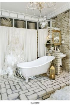 Would love to own a clawfoot bathtub and have an exposed brick wall!