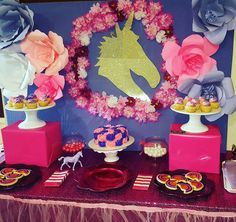 The backdrop at this Princess and Unicorn Birthday Party is just so pretty. Love the paper flowers!See more party ideas at CatchMyParty.com