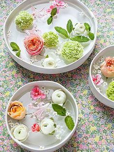 Place the heads of your favorite blooms in a shallow bowl filled with water (wide, flat flowers like open roses and hydrangeas work best). Here, mint sprigs add a fresh scent.