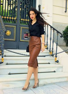 Black dress shirt, brown leather pencil skirt, snakeskin heels with brown cap toe, and black bag