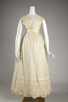 c. 1820 [under] dress, American or European. The Met, C.I.42.152.2.  [A combination underdress and petticoat like this was worn under sheer net gowns. Pleating, tucking, and embroidered detail would show through the sheer overgown for more visual interest.]