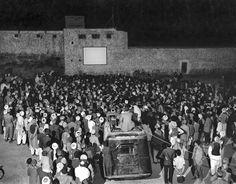 People in Kabul, Afghanistan, enjoy an American movie outdoors. 1950s