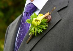 Very nice ranunculus boutonniere accented with brown fiddlehead. Created by Emily Herzig Floral.