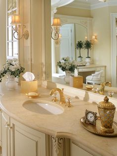 This HGTV bathroom takes elegance to the next level by adding gold and crystal fixtures.