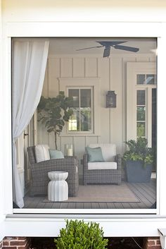 white arts and crafts style siding, fig tree, summer classics outdoor wicker furniture