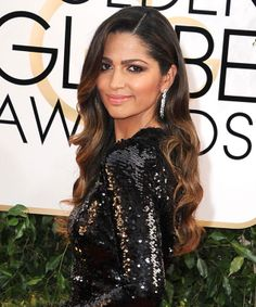 Tuck Your Waves Behind Your Ear  Camila Alves might've only attended the Golden Globes as Matthew McConaughey's date, but those are nominee worthy waves. Try it by softening your curls with a boar bristle brush after you've curled your hair.