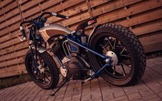 Custom rigid motorcycle by Ivan Moto  | Based on Buell Blast single cylinder 492cc engine | Chain drive conversion | Suspended wooden seat w/ integrated LED light | Aluminium bodywork w/ wood panels inserts | One-off girder type fork | Bar-end levers | Photography by Petr Toluzakov | Russia | via InazumaCafe.com