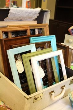 This could be so easy to make! Grab some thrift store frames and attach some wire to hang jewelry from.