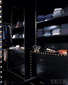 Decorator Steven Gambrel crafted a bespoke dressing area with ebonized shelving trimmed with square brass tacks | via Handsome Sexy Man Rooms ~ Cityhaüs Design