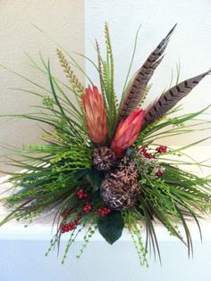 Handmade Repen Pods & Feathers Silk Floral Arrangement - Tile Topper Arrangement. $52.00, via Etsy.