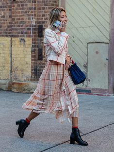 Australia Fashion Week Street Style from Sydney: Pretty checked print pieces clashes against black ankle boots