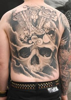 Black grey big skull with various mechanisms tattoo on back