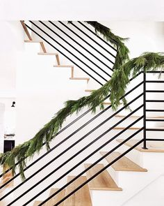 Holiday garland on beautiful staircase.