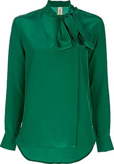 I need an emerald green tie-neck blouse.  This fits the bill.
