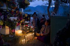 A tomb decorated with candles and flowers, San Antonio Aguascalientes, Guatemala, Nov. 1