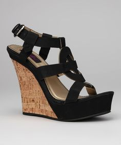 <p+style='margin-bottom:0px;'>Step+by+step+and+trend+by+trend,+these+sandals+are+one+hot+find.+A+sky-high+wedge+and+platform+base+offers+an+abundance+of+height,+while+a+buckle+in+back+customizes+the+fit.<p+style='margin-bottom:0px;'><li+style='margin-bottom:0px;'>5''+heel+with+1.5''+platform<li+style='margin-bottom:0px;'>Buckle+closure<li+style='margin-bottom:0px;'>Man-made<li+style='margin-bottom:0px;'>Imported<br+/>