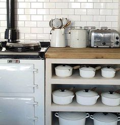 White Aga, subway tiles, dualit toaster, open shelving with Le Creuset pots and pans. Rustic Kitchen, New Kitchen, Kitchen Dining, Kitchen Decor, Space Kitchen, Kitchen White, Kitchen Things, Vintage Kitchen, Devol Kitchens