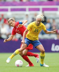 Sweden's Caroline Seger (right) vies for the ball with Canada's Christine Sinclair