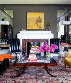 more mirror panelling, more bold colors, hot pink flowers, leather and texture... oh my.  love.