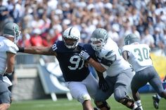 PENN STATE – FOOTBALL 2013 – DAQUAN JONES beats block of EMU lineman, reaches out and grabs QB Tyler Benz, then gets help from linebacker Glenn Carson on sack. The weatherman dialed up a perfect day for football in Happy Valley Saturday, and the Nittany Lions did their part to make fans in Beaver Stadium enjoy the delightfully warm, sunny afternoon by running through, over and around Eastern Michigan, 45-7.