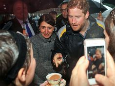 Prince Harry Gets 'Em Soaking Wet Down Under (PHOTOS)