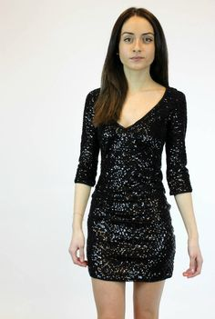 Sparkle in this black sequin dress for #NYE2015! Check Up On It Dress now available in black and gold! #ShopVamped #SequinSoiree #SequinDresses