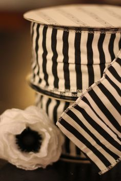 10 yard roll of black and white striped wired ribbon. $32.00, via Etsy.