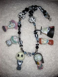 ***THIS ITEM IS RESERVED*** 12/21/11  Hey Friends  You are looking at a wonderfully fun, spooky and original Nightmare Before Christmas, Jack Skellington/ Sally beaded necklace :) This necklace is rather long to accomadate all the plastic figure :) This super fun, super kawaii necklace is beaded with glass, resin, clay and crystal beads <3  and is perfect for any Nightmare or Jack Skellington fan alike :) As always thanks for looking and if you have any questions please convo me <3  xoxo