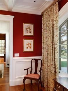 In this stunning dining room, the homeowner's existing furniture was reupholstered with fabric that worked well with the red silk wallpaper and Italian silk drapes.