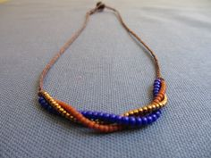 Handmade Necklace - seed beads,  chocolate waxed irish linen. $20.00, via Etsy.
