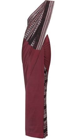 Deep red chanderi sari, printed in black and white Ikkat print. The story carries forward to the choli. Colourful wheels make up the trims of the sari. It comes with a printed blouse piece. From Anupamaa Dayal   perniaspopupshop.com