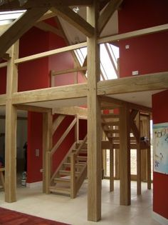 Oak frame and red walls in Oxford house. By Roderick James Architects.