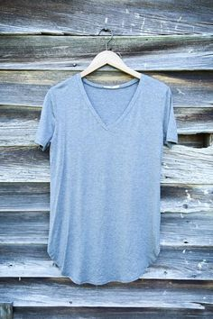 Wear all day every day...no matter the season! Our v-neck Timeless tee in charcoalis basic and versatile; Wear with shorts in the summer, a kimono in the spring, blazer in the fall, and thick cardigan in the winter. Don't forget to accessorize with your fave statement necklace as well! The possibilities are endless.  View More Colors   GENERAL INFO:   95% Rayon, 5% Spandex Machine wash delicate; Hang dry Neckline: V-neck Side slits Long Made in USA   FIT GUIDE:   Fit: T-shirt Fabric…