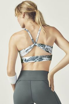 Medium support in front and major style in back: say hello to your new main squeeze, an oh-so-pretty sports bra that features breathable keyhole details in front and back, a wider band for extra support and removable cups. | Fabletics Kenzie Sports Bra