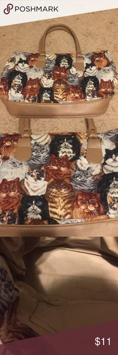 Amazing Cat lovers Handbag!❤️ Cloth and faux leather handbag. Gently used, great condition! Velcro closure, mild markings in bottom of bag-see pics. Synthetic internal liner with small zippered interior pocket. Measures 15x10 inches. Handle drop 7 inches. Vintage Bags