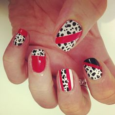 Dalmatian spots with red and black stripes.