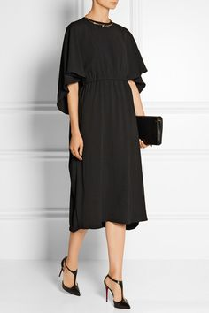 Black crepe Slips on 82% triacetate, 18% polyester Dry clean