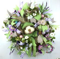 Mesh Burlap Easter Bunny Wreath with Bunny Head, Flowers, Ribbon and Easter Eggs by www.southerncharmwreaths.com #easterdecor #burlap #bunny