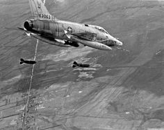 US Air Force North American F-100 Super Sabre dropping two 500lb bombs on Viet Cong targets in the Mekong Delta, 1965.