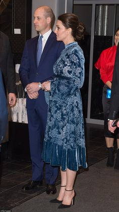 The Duchess teamed her velvet Erdem dress with a pair of simple black suede heels with an ...