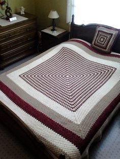 You can see the big box containing many boxes of small size within it; this is also an amazing idea for crocheting unique design of bedspread. Maroon, gray and white combination is making the bedspread look sober. It is also giving a great look to the bed.