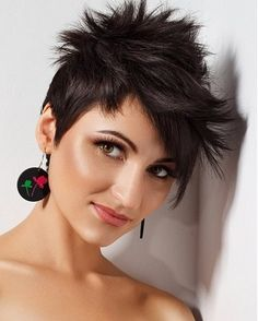 A short black straight spikey hairstyle by Party Hair