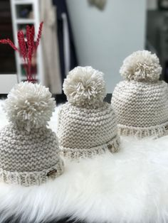 Gorgeous oversized pompom hat which looks adorable on a little cutie.  This is 6-12 month size is suitable for head circumference approx 44cm.  Soft and cosy hand knit.