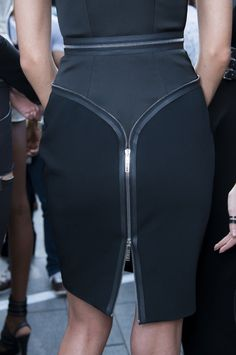 The details on this pencil skirt take it to the next level, not to mention what it does for your rear view!
