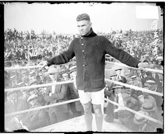 Jack Dempsey standing in a corner of a boxing ring outdoors in Benton Harbor