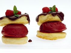 Food Network invites you to try this Mini Pancakes with Raspberry Sorbet and Chocolate Sauce recipe from Giada De Laurentiis.