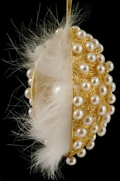"Necklace | Barbara Heinrich. ""Secret Treasure"". 18k yellow gold mesh pod pendant covered in seed pearls with rabbit fur and a white South Sea cultured pearl in the centre"